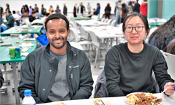Two students at the 2018 Thanksgiving Unity Dinner